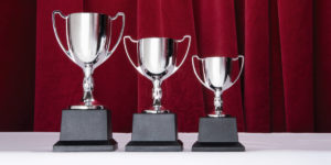 Three silver trophies --- Image by © Image Source/Corbis