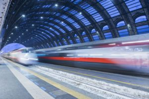 Motion blur of speeding train in train station; Milan, Lombardy, Italy
